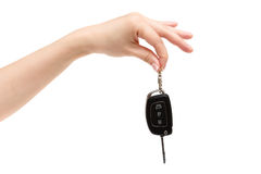 Female hand holds car keys. Female hand holds car keys on white background Stock Image