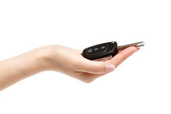 Female hand holds car keys on white background. Female hand holds car keys Stock Image