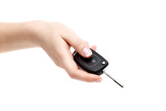 Female hand holds car keys. Female hand holds car keys on white background Royalty Free Stock Image