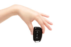 Female hand holds car keys. Female hand holds car keys on white background Royalty Free Stock Photos