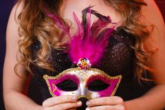 Female hand holds carnival mask closeup Stock Photography