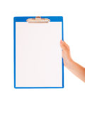 Female hand holds clipboard with empty blank sign Royalty Free Stock Image