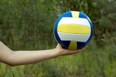 Female hand holds in her palm sports ball for playing volleyball Stock Images