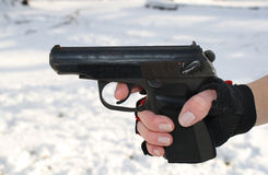 The female hand holds a pistol Stock Image