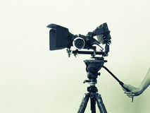 Female hand holds professional camera taking photos Stock Photos