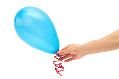 Female hand holds single blue party balloon. isolated on white background Stock Photography