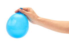 Female hand holds single blue party balloon. isolated on white background Royalty Free Stock Photo