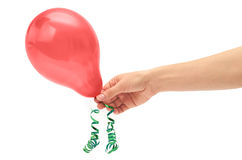 Female hand holds single red party balloon. isolated on white background Royalty Free Stock Images