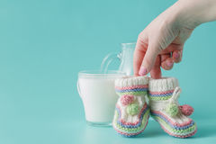 Female hand holds small baby shoes Stock Photography