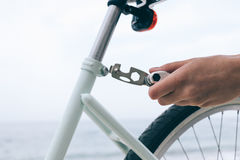 Female hand holds the tool to fix bike Stock Images