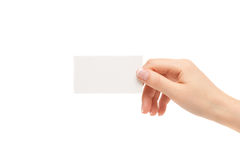Female hand holds white card on a white background. Female hand holds white card on a white background Royalty Free Stock Photography