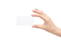 Female hand holds white card on a white background. Isolated female hand holds white card on a white background Stock Photography