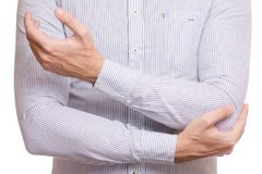 Female hand hurts the arm of the elbow stock image
