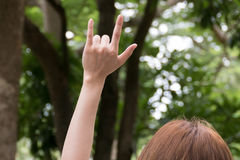 Female hand with I love you finger gesture. woman showing symbol Royalty Free Stock Photos