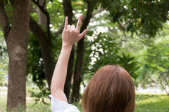 Female hand with I love you finger gesture. woman showing symbol Royalty Free Stock Photography