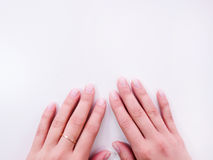 Female hand with ideal manicure top view. Neat hands with perfect nails on white background stock images