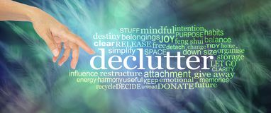 Consider Clutter Clearing Word Cloud. Female hand with index finger pointing towards the word DECLUTTER surrounded by a relevant tag word cloud on a  blue green Stock Photos