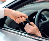 Female hand inside the car getting keys Stock Image