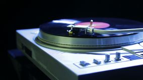 Female hand installs a turntable needle on a vinyl record. Hd stock video footage