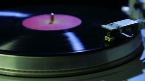 Female hand installs a turntable needle on a vinyl record. Hd stock footage