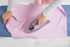 Female Hand Ironing Cloth Stock Photography