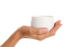 Female hand with jar of body lotion Stock Photos