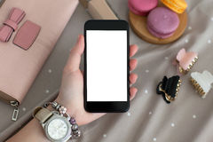 Female hand with jewelry and watch holding phone isolated screen Royalty Free Stock Images