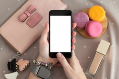 Female hand with jewelry and watch holding phone isolated screen Royalty Free Stock Photos