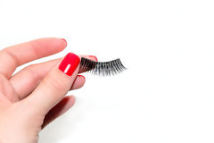 Female Hand is Keeping False Lashes. The Girl is Stock Image