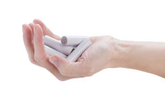 Female hand kept in an armful batteries Royalty Free Stock Photos