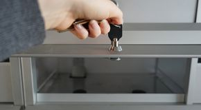 Female hand with keys and empty metal mailbox close-up stock images