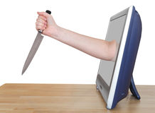 Female hand with kitchen knife leans out TV screen Royalty Free Stock Photography