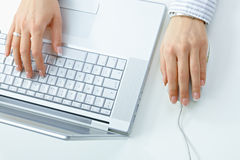 Female hand with laptop Royalty Free Stock Images