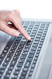 Female hand on laptop keyboard Royalty Free Stock Photo