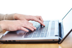 Female hand on laptop keyboard Royalty Free Stock Images