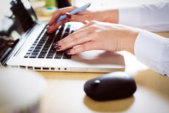 Female hand on a laptop keyboard Royalty Free Stock Photography