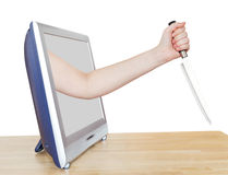 Female hand with large kitchen knife leans out TV Royalty Free Stock Images
