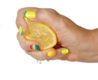 Female hand with lemon Stock Photos