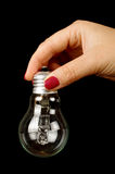 Female hand with light bulb isolated on the black background Royalty Free Stock Photography