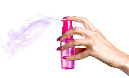 Female hand with long nails holds a bottle Royalty Free Stock Photography