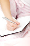 Female hand making notes in callendar Royalty Free Stock Images