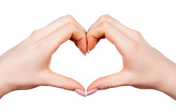 Female hand making sign heart. Isolated on white background stock photography