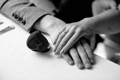 Female hand on male hand on a table royalty free stock photos