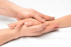 Female hand in male hands closeup. Stroking massage Stock Images