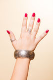 Female hand with manicure and armlet Stock Photo
