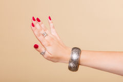 Female hand with manicure and armlet Royalty Free Stock Images