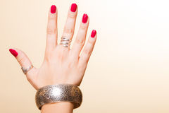 Female hand with manicure and armlet Stock Photos