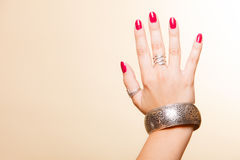 Female hand with manicure and armlet Stock Image