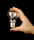 Female hand with manicure holding electric lamp Royalty Free Stock Photography