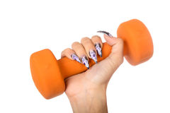 Female hand with manicure holds  dumbbell isolated Stock Photos